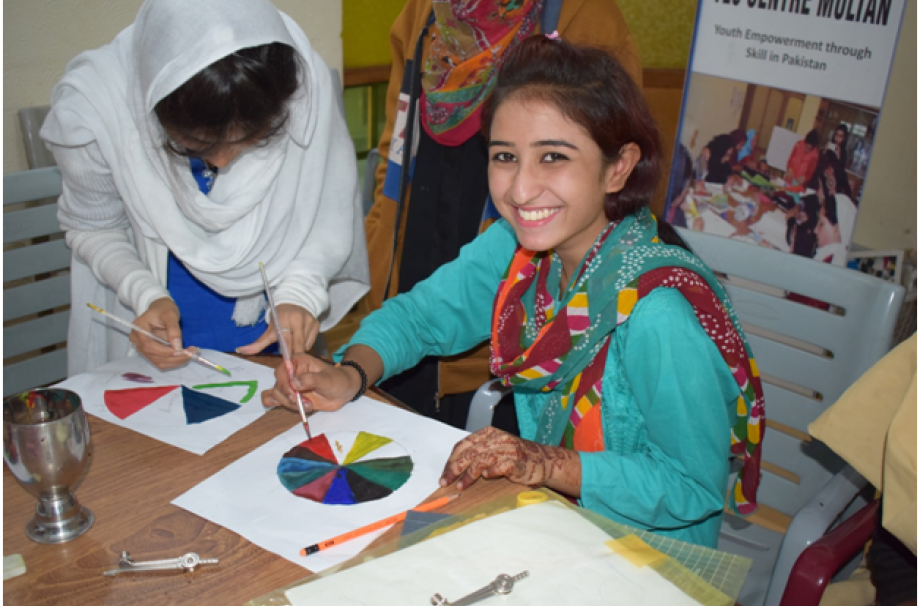 Young girl enjoying the color session at YES Center, Multan